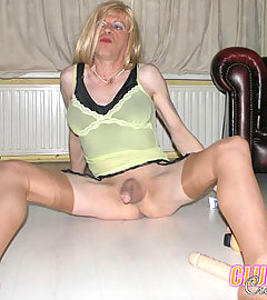 This crossdressing slut has his cock tied up and is loving it