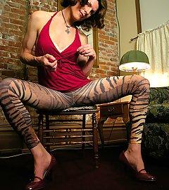Horny tgirl with big, cummy hard-on in animalistic tights.