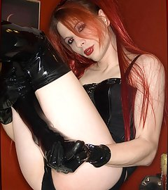 Pale and thin, Jamie slips on some latex leggins and teases herself with a black translucent dildo
