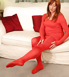 Slutty TGirl Lucimay wearing some red opaque leggings