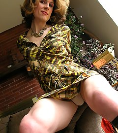 Transwoman Delia in leather boots and dress displaying upskirts.