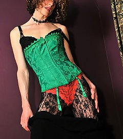 Sweet witchy tgirl in black lace pantyhose & poison green corset.