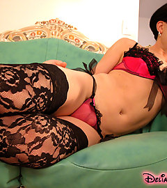 Brunette bombshell in black lace thigh highs exhibits a stiffy.