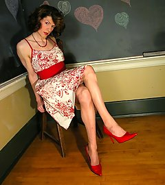 Retro-styled Tgirl Delia dressed up for the dance in nylon hose.