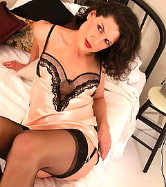 Sultry Delia in stockings, satin, black lace & 6-strap garter belt.
