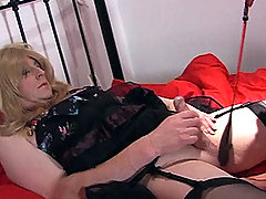 Nylon Jane gives one of her famous footjobs to this horny TGirl slut.
