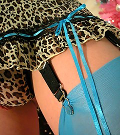 Hot TGirl Delia in blue stockings & leopard-print lingerie.