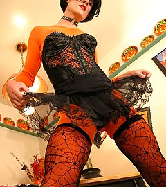 Pumpkin queen with she-cock in tights & spiderweb thigh highs.