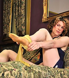 Shemale shimmers in gold pantyhose stretched taught by her she-cock.
